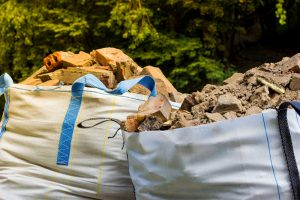 Wastes,From,The,Production,Or,Renovation.,Two,Big,Bags,Container